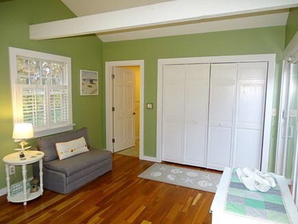Eastham Cape Cod vacation rental - Seating area in dining room, towards full bath, laundry room