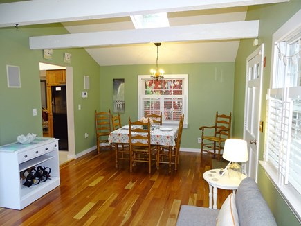 Eastham Cape Cod vacation rental - Dining area, showing entrance into kitchen