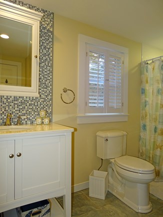 Eastham Cape Cod vacation rental - Laundry stacked next to shower and tub