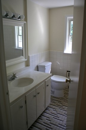 Chatham Cape Cod vacation rental - Primary bathroom with tub/shower.