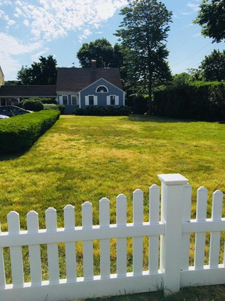 Hyannis Cape Cod vacation rental - View from street - green space for ball/games -2 parking spots