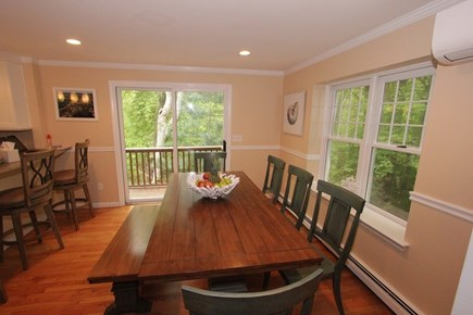 North Falmouth Cape Cod vacation rental - Dining Room Table w/ slider to Back Deck