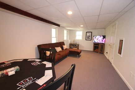 North Falmouth Cape Cod vacation rental - Basement with Games, Foosball Table and Living Area