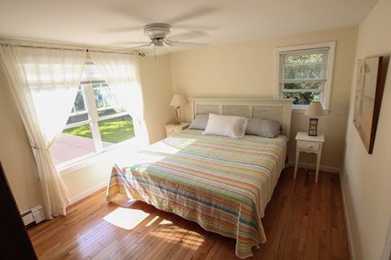 Dennisport Cape Cod vacation rental - King bed on second floor with ceiling fan.
