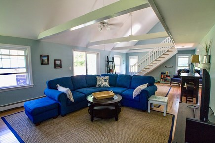 Dennisport Cape Cod vacation rental - Family room with hardwood floors, wifi, cable and ceiling fans.