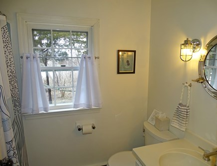 Eastham-Boat Meadow Beach area Cape Cod vacation rental - Main floor nautical bathroom with tub/shower.