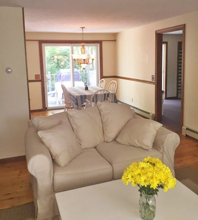 East Dennis Cape Cod vacation rental - Open living and dining area, slider to deck with outdoor seating