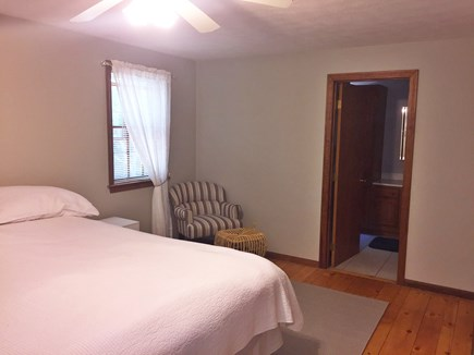 East Dennis Cape Cod vacation rental - Master bedroom, reading chair and ottoman