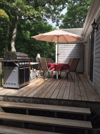 East Dennis Cape Cod vacation rental - Back deck with propane grill and patio furniture