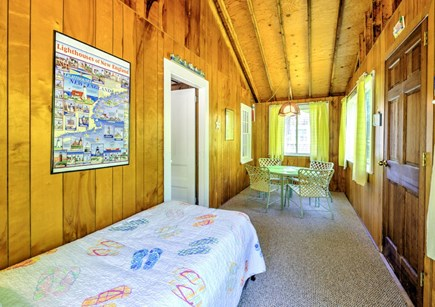 East Sandwich Cape Cod vacation rental - Trundle and table on sleeping porch.