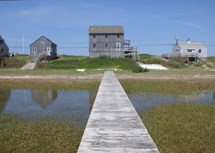 East Sandwich Cape Cod vacation rental - View of house and dock from the road side.