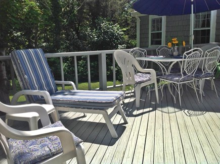 East Orleans  Cape Cod vacation rental - Deck with chaises, chairs and dining under the umbrella.