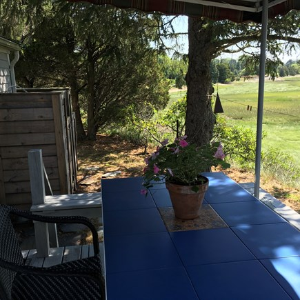 Eastham Cape Cod vacation rental - Deck dining under the awning with views