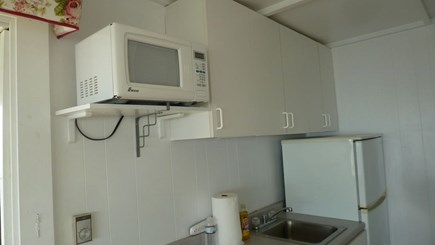 North Truro Cape Cod vacation rental - Kitchen, with stove top, microwave and refrigerator