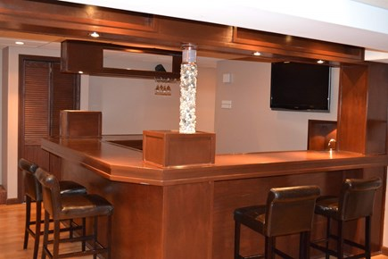 Harwich Cape Cod vacation rental - Finished basement with bar, TV, and video game console