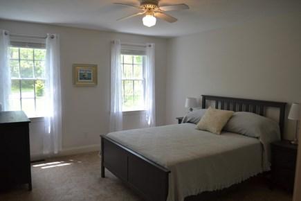 Harwich Cape Cod vacation rental - First floor master bedroom with queen bed and en-suite bathroom