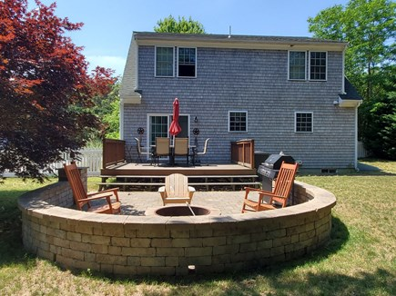 Harwich Cape Cod vacation rental - Rear deck, patio, and fire pit, within spacious fenced-in yard
