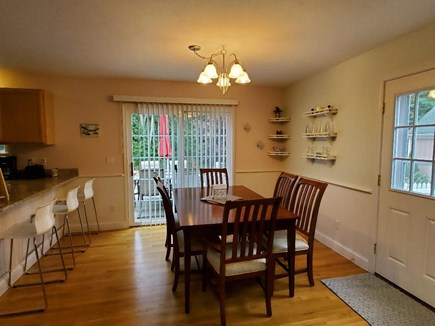 Harwich Cape Cod vacation rental - Dining room overlooks deck and patio