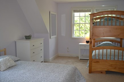 Harwich Cape Cod vacation rental - Second floor bedroom with one full bed and two bunk beds