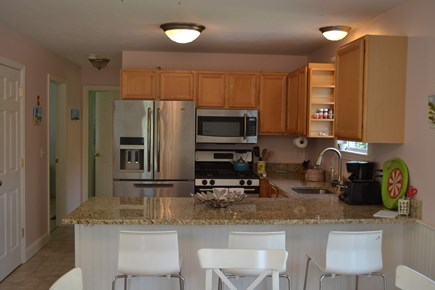 Harwich Cape Cod vacation rental - Kitchen and breakfast bar (washer/dryer, microwave, dishwasher)