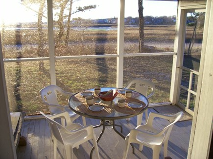 Wellfleet Cape Cod vacation rental - In the screened porch dining & views