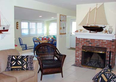 East Sandwich Cape Cod vacation rental - Downstairs living room with fireplace