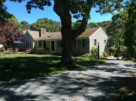 Eastham Cape Cod vacation rental - Guests' driveway, blue lawn light, and steps down to deck