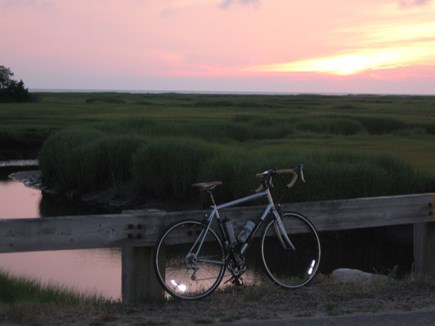 Eastham Cape Cod vacation rental - On the bicycle bridge to Coast Guard Beach at sunset.
