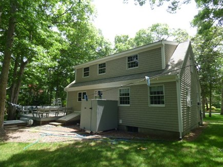 Dennis Cape Cod vacation rental - Back of house with outside shower and deck