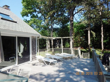 West Chatham Cape Cod vacation rental - Spacious deck with lounge chairs and dining table with chairs.
