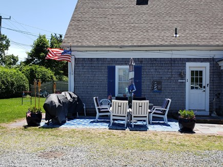 Dennis Port Cape Cod vacation rental - New Sun Setter dining area, 2 Weber grills, comfortable, & cozy!
