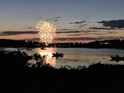 North Chatham Cape Cod vacation rental - View of the fireworks and sunset over Crow's Pond from the deck