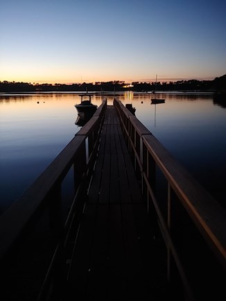 North Chatham Cape Cod vacation rental - Dock and boats at sunset