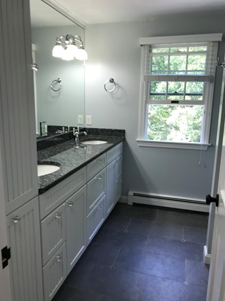 Brewster Cape Cod vacation rental - Upstairs bath has double sinks, toilet, full tub w/ glass door