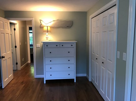 Brewster Cape Cod vacation rental - Master bedroom has two dressers and AC.