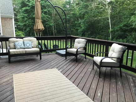 Brewster Cape Cod vacation rental - Large deck with patio furniture, huge umbrella  & Weber grill.