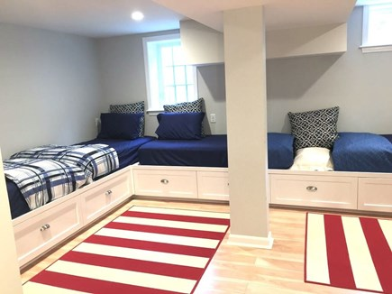 Hyannis Cape Cod vacation rental - Lower level bunk room with 4 built-in captain's beds