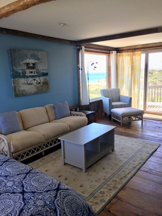 South Wellfleet on the Ocean Cape Cod vacation rental - Master bedroom sitting area with sliders to the deck