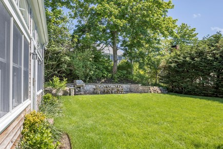 Chatham Cape Cod vacation rental - New stone wall and patio for grilling.