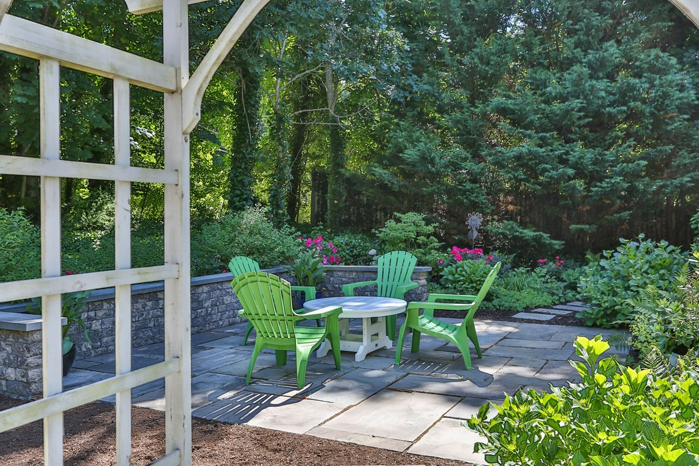 Serene Private Patio Surrounded By Gardens And Nature.