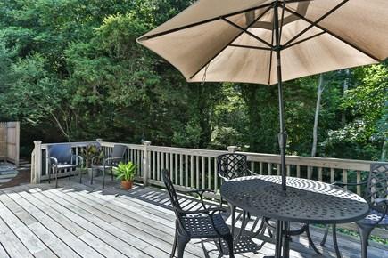 East Orleans Cape Cod vacation rental - Huge back deck with table for dining alfresco!