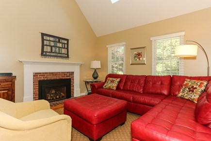East Orleans Cape Cod vacation rental - Inviting  living room with comfortable sofa & cathedral ceiling.
