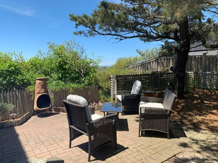 Eastham Cape Cod vacation rental - Side patio for more entertaining.