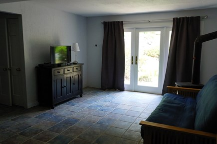 Truro Cape Cod vacation rental - Lower living area with futon and TV, access to back deck