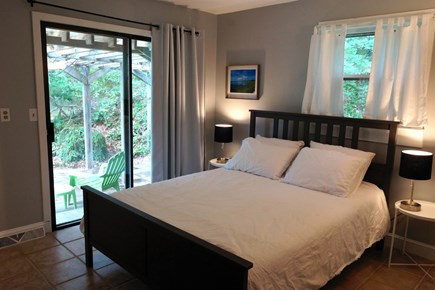 Truro Cape Cod vacation rental - Upstairs bedroom with queen bed, ensuite half bath and sliders
