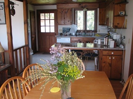 South Chatham Cape Cod vacation rental - Dining room table seats 8, kitchen has granite counter tops