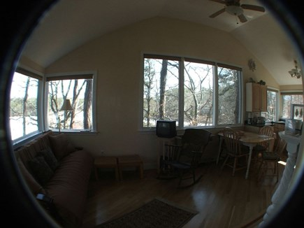 Eastham Cape Cod vacation rental - Living room looking into dining/kitchen surrounded by water views