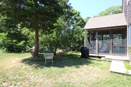 Truro Cape Cod vacation rental - Screen porch, outdoor seating, hammock and gas grille