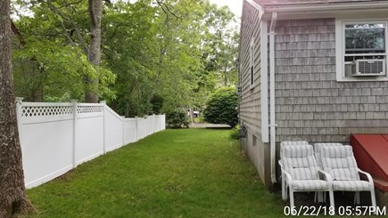 South Yarmouth Cape Cod vacation rental - Partially fenced yard with extra seating