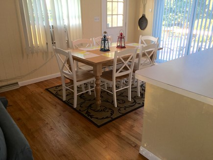 Falmouth Cape Cod vacation rental - Dining area (deck and backyard beyond sliders)